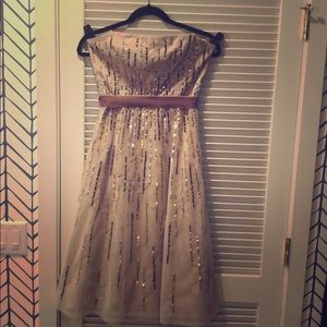 Strapless nude sequins dress.